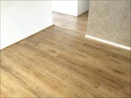 How To Remove Adhesive From Laminate Flooring Putting Wood Floor Over Linoleum Thefloors Co