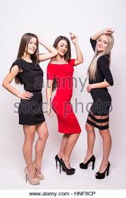 three lovely young women in night dresses send kisses over white