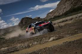 peugeot dakar sebastien loeb scores third stage win to extend dakar lead