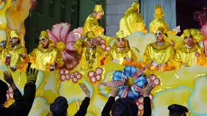 mardi gras trinkets new orleans la circa february 2014 masked on a float