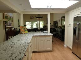 traditional kitchen with flat panel cabinets u0026 skylight in