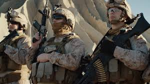 squad of fully equipped soldiers standing in a line in the desert