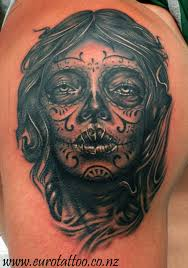 sugar skull on shoulder photos pictures and