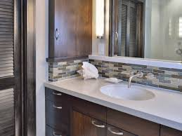 mosaic tile backsplash adds beauty and texture to modern bathroom