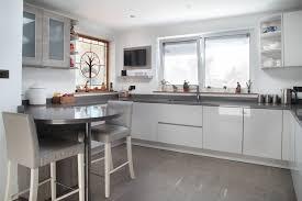 white gloss kitchen floor cupboard light grey high gloss kitchen with silestone worktop