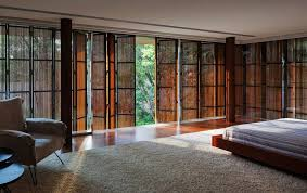 Glass Wall House by Long Glass House With Folding Wooden Facade