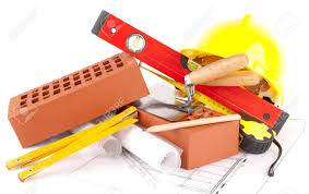 mason tools and house construction plans stock photo picture and