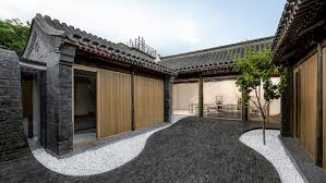 courtyard home undulating paving connects inside and outside spaces at twisting