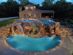 two level luxury pool with waterfalls slide swim up bar and spa