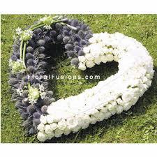 funeral wreaths eryngium spray heart funeral flowers leicester funeral