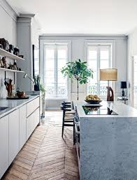 modern french kitchen tour a modern french apartment with historic bones chevron floor