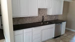 kitchen remodel third pic white cabinets with new caledonia granite medium grey and subway tile project for retail client his wife love the