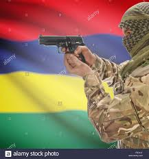 Mauritius Flag Man With Gun In Hand And National Flag On Background Series Stock