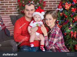 happy family celebrating christmas all together stock photo