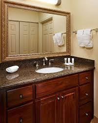 classy double round bowl sink on brown granite countertop