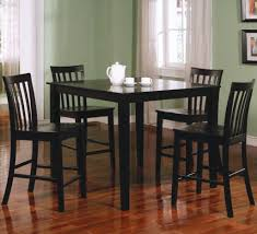 square black wooden dining table with four legs added by four