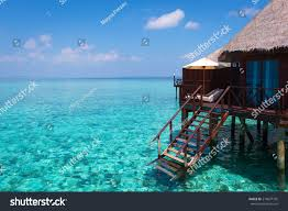 turquoise lagoon tropical ocean overwater bungalow stock photo