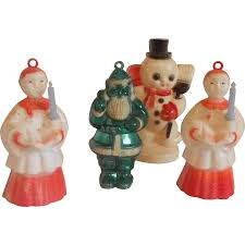 four plastic ornaments choir boys santa snowman from
