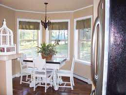 decorating traditional dining room design with elegant bay window