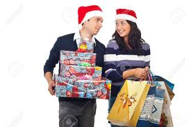 young couple with santa hat having conversation and holding