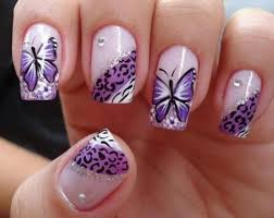 purple leopard print and butterfly nail