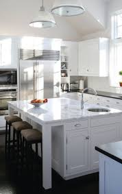 gripping marble top kitchen island with round undermount stainless