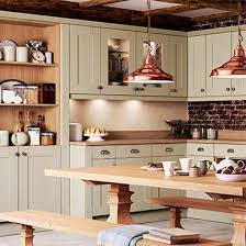 lewis kitchen furniture green cupboards and wooden worktop and copper pendant lights