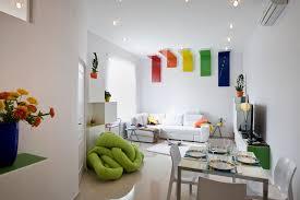 flat design ideas photos hgtv midcentury modern sitting area with white furniture