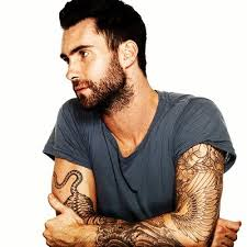 adam levine flower and wing on right arm tattoomagz