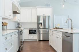 white kitchen cabinets with tile floor coastal kitchen with white cabinets wood look tile floors