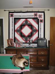 How To Hang Pictures On Wall by How Do You Hang Your Wall Quilts Without Making Holes In The Wall