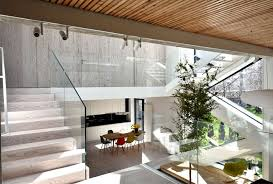 spectacular play of volumes and materials into modern split level