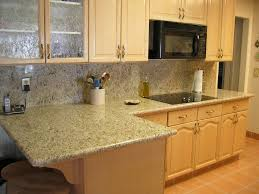 simple kitchen design with giallo ornamental granite countertops