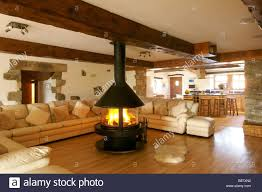 large wooden beams and island unit in barn conversion kitchen with