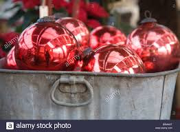 red christmas tree baubles in tin bucket stock photo royalty free