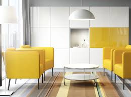 a living room with yellow armchairs a white round coffee table