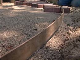 laying pavers over concrete patio laying paving slabs on soil how to lay sand install lawn edging
