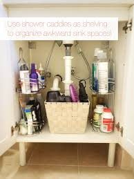 bathroom organization ideas for small bathrooms 15 sneaky storage tricks for a tiny bathroom shower caddies