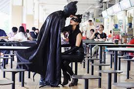 batman proposes singaporean couples dress as batman and superman
