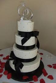 ring cake topper tier white wedding cake with black bows and diamond and