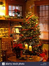 craftsman home living room interior with christmas tree and