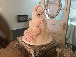 wedding cake gum side view buttercream cascading wedding cake ivory