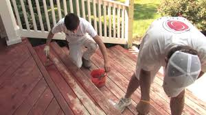 is it better to stain or paint my wood deck youtube