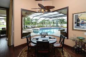 Dining Room With Ceiling Fan by Tropical Dining Room With Atrium U0026 Hardwood Floors In Weston Fl