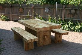Old Wooden Table And Chairs Outdoor A Brown Wooden Table And Chairs Then With Paving Plant