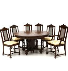 vintage oak jacobean revival dining table and six chairs ebth