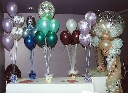 kids party centerpieces purple and blue ballons they are