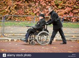 disabled war veteran and old soldier in a wheelchair at the stock