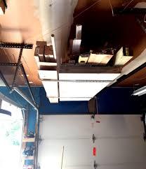 scrap wood storage bin easy diy tutorial for storing utilizing garage ceiling space for additional storage