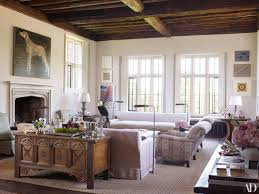 habitually chic tudor mansion many people eschew traditional architecture because they think it can t look modern or work for a young family claudia schiffer s historic english tudor